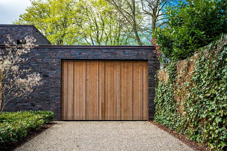 wide-garage-door-and-concrete-driveway-in-front
